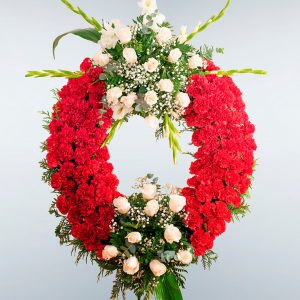 Corona de flores roja de claveles con dos cabeceros para enviar al tanatorio de Toledo y provincia.